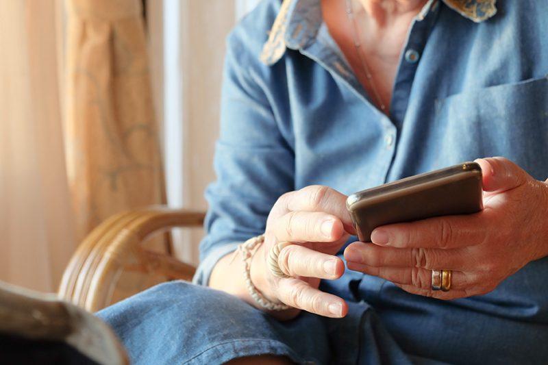 older woman using smart phone